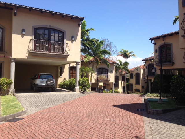Two story house in condominium with patio, office, TV room