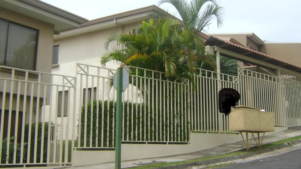 Home in condominium with patio, secure residential