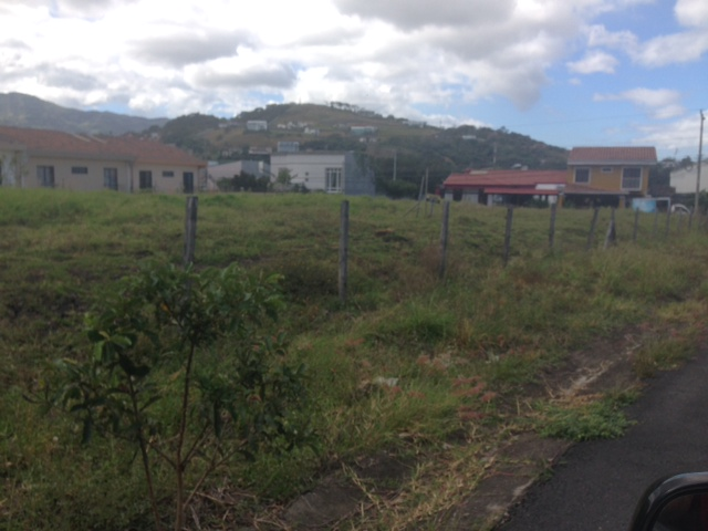 Flat lot ready to build condo in central location