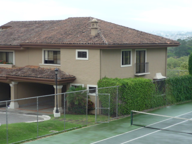 Home with private garden and terrace in condominium with pools, tennis, playground