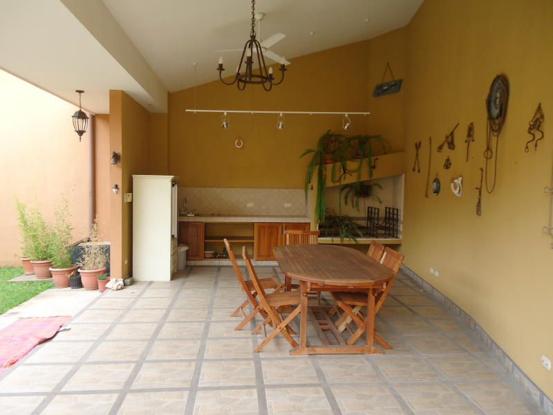 Furnished one level home, covered terrace and gardens with waterfall
