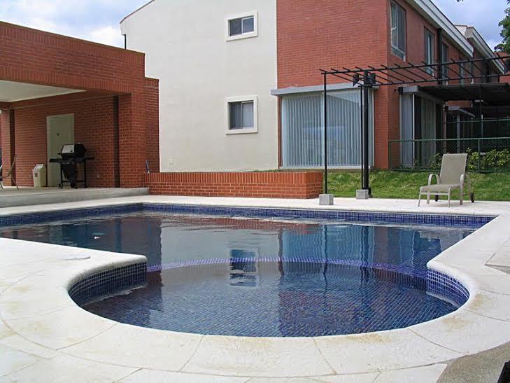Contemporary house in condominium with pool