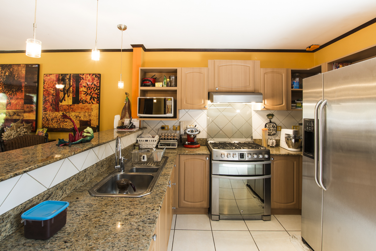 Two story corner home in condominium with nice swimming pool