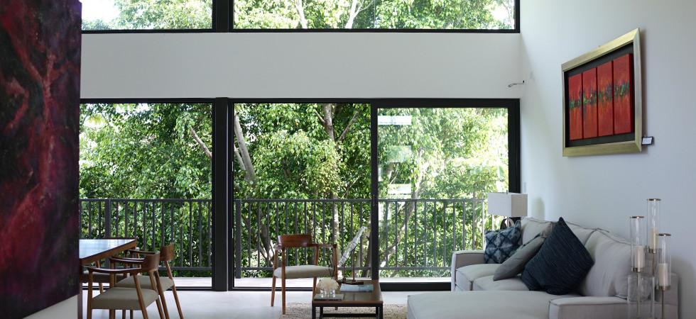 New, modern two story home in small condominium near Multiplaza
