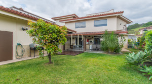 Two story home with garden and views in private residential